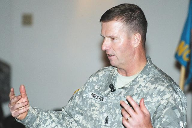 Sgt. Maj. of the Army Kenneth Preston responds to questions from Fort Gordon Soldiers during a town hall session, April 10.