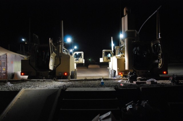 BAGHDAD - Soldiers of 576th Engineer Company (MAC), 4th Eng. Battalion, 225th Eng. Brigade, at Camp Liberty prepare their two RG 31 mine resistant ambush protected vehicles for a night mission March 26.  The Soldiers of this platoon work the night shift performing route clearance operations.