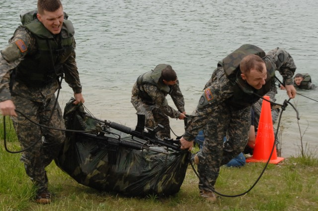 "Last year's competitors struggle toward the finish line after the poncho raft build and float challenge during the ""Best Sapper"" competition, which puts the top engineers in the Army into competition against one another. This year, 34 teams are competing to determine the ""best of the best."""