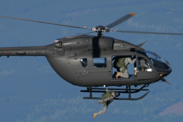 A Fort Polk Soldier jumps from a Lakota LUH 72A helicopter during high altitude, low open airborne operations April 8, while another Soldier prepares to jump. The event marked the first time a Lakota was used in airborne operations on Fort Polk and just the third time Army wide.