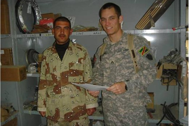 Staff Sgt. David Timmons, 356th Quartermaster Company, and an Iraqi Army Soldier take inventory of Class IX repair parts in a warehouse at Kirkush Military Training Base, Iraq. Timmons trained the IA on how to properly receipt, store, issue and account for all their repair parts.