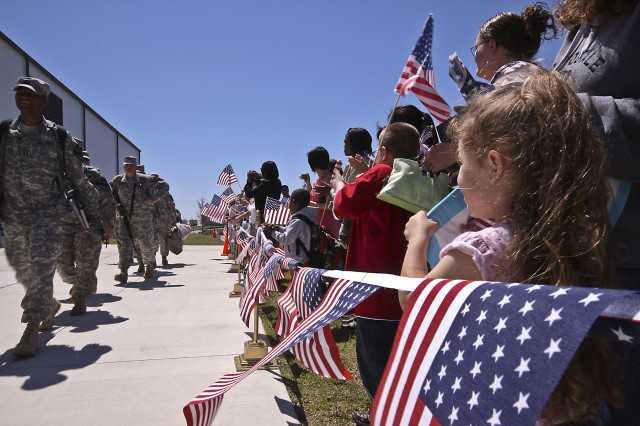 Soldiers of the 1st Air Cavalry Brigade, 1st Cavalry Division, begin their journey to Iraq, as family members proudly cheer on their loved ones during a deployment ceremony on Fort Hood, Texas, April 20.