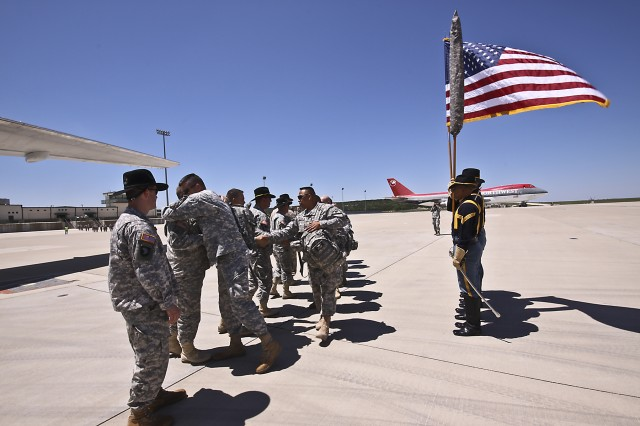 Soldiers of the 1st Air Cavalry Brigade, 1st Cavalry Division, who are deploying to Iraq, are sent off by Canadian Army Brig. Gen. Peter Atkinson, III Corps deputy commanding general, along with leadership of the 1st Air Cav. Bde., and the 1st Cav. Div. Honor Guard at Gray Army Air Field, Fort Hood, Texas, April 20.