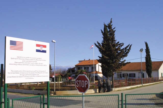 A site inspection group gathers near the newly renovated playground in Debeljak, Croatia. The U.S. Army Corps of Engineers Europe District managed the $130,000 EUCOM-funded renovation.