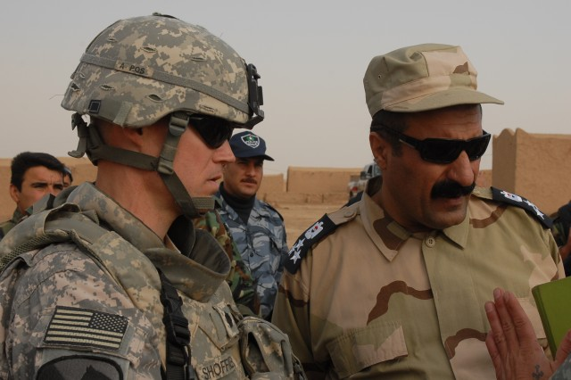 Lt. Col. Andy Shoffner, the commander of 4th Squadron, 9th U.S. Cavalry Regiment, 2nd Brigade Combat Team, 1st Cavalry Division, and Brig. Gen. Sarhad Qadir, the police chief of the country area in Kirkuk province, discuss an operation April 7th in a small village in Kirkuk province.