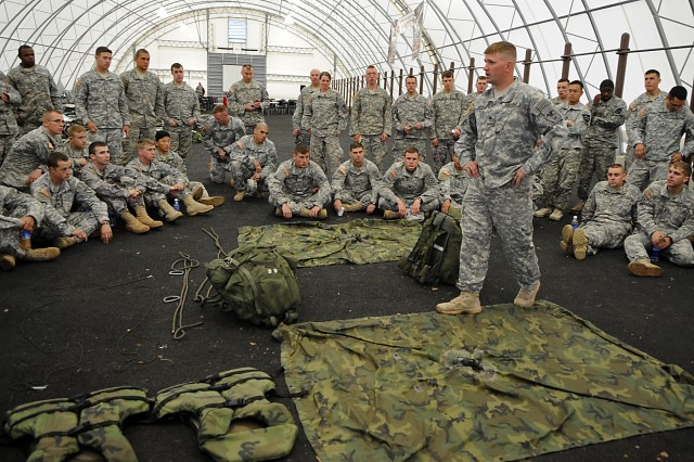 "Army engineers are instructed how to build a poncho raft prior to the raft build and challenge during the 2009 ""Best Sapper"" competition at Fort Leonard Wood, Mo.  A total of 34 two-person teams are competing in the grueling competition to determine the Army's best engineers."