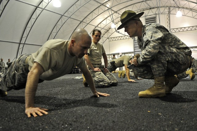 """Sgt. 1st Class Christopher Reinhard tries for the maximum number of push-ups during the first phase of the """"Best Sapper"""" competition at Fort Leonard Wood, Mo. Teams from as far away as Hawaii and Germany are testing their engineers skills to determine the best of the best."""