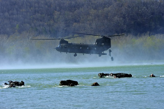 """Competitors in the 2009 """"Best Sapper"""" competition compete in the helocast poncho raft swim during phase two at Fort Leonard Wood, Mo.  More than 70 of the Army's top engineers vie for the best of the best honors during a six phase, 52-hour"""