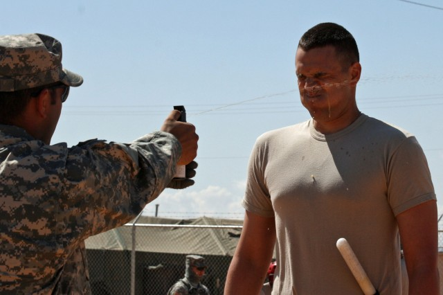 A Guardsman from B Company, 1st Battalion, 128th Infantry Regiment, 32nd Infantry Brigade Combat Team, is sprayed with Oleoresin Capsicum gas during detainee-operations training at McGregor Range, N.M.