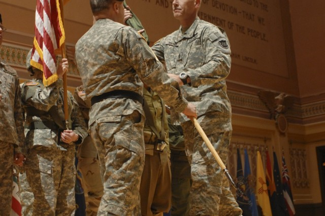 Maj. Gen. William Monk III, 99th RSC commanding general, hands the cased 99th RRC flag to Command Sgt. Maj. Kurtis J. Timmer of the 99th RSC during the casing of the colors ceremony at the Soldiers and Sailors Memorial Hall in Pittsburgh, Pa., April 19.