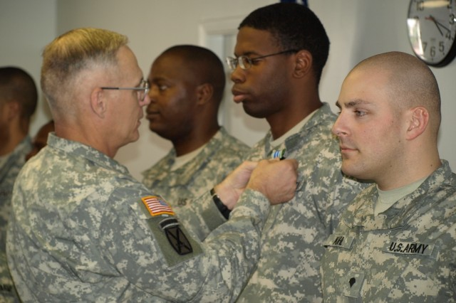 Maj. Gen. James Terry presents the Army Achievement Medal to Spc. Forna Diphicyl, Spc. Thomas Atchinson, Spc. Michael Kihl""