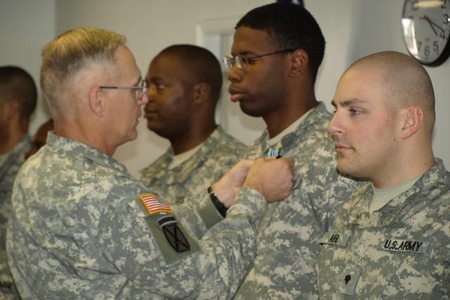 "Maj. Gen. James Terry presents the Army Achievement Medal to Spc. Forna Diphicyl, Spc. Thomas Atchinson, Spc. Michael Kihl"""