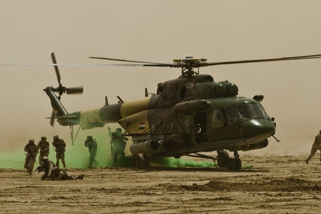 Iraqi Soldiers exit an Iraqi Air Force helicopter during the combined arms live-fire exercise in the Maysan province April 19. The training event displayed the Iraqi military's and Long Knife Brigade's cooperation in missions and sharing of