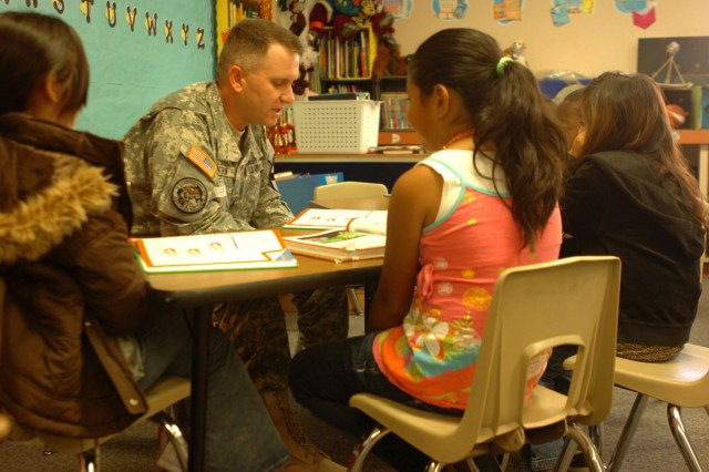 Staff Sgt. Mattern Matthew, 3rd Brigade Special Troops Battalion, 3rd Heavy Brigade Combat Team, 1st Cavalry Division, Rear Detachment from Meadville, Pa., reads with third graders April 20, through the battalion's Adopt-A-School program at Maxdale Elementary School in Killeen, Texas.