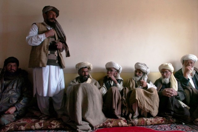 Elders from the village of Kalagu in the Zormat District, Paktya province in eastern Afghanistan discuss concerns they have with the establishment of Combat Outpost Kalagu with the commanders of the Afghan National Army and their U.S. counterparts during a Shura, April 15.