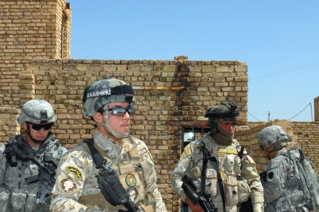 BAGHDAD - Sgt.1st Class Arnold Berger (left) , a native of Germansville, Pa., who is a cavalry scout platoon sergeant assigned to B Troop, 2nd Squadron, 104th Cavalry Regiment, 56th Stryker Combat Team joins members of the 3rd Battalion, 22nd Brigade, 6th Iraqi Army Division as they patrol the streets of Sab al-Bour.  The continuous presence of the Iraqi Security Forces and the Coalition forces give the people in the community a great sense of security.