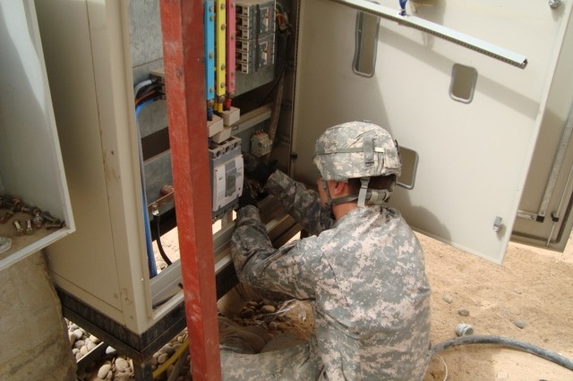 BAGHDAD - Pvt. Daniel Almquist, 46th Engineer Combat Battalion (Heavy), 225th Engineer Brigade, an electrician from Chicago, installs a main distribution panel for electricity at the newly-built battalion aid station on Joint Security Station Ur March 28.