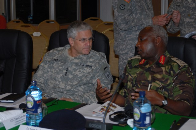 MOMBASA, Kenya - Gen. George W. Casey, Jr., U.S. Army chief of staff, and Lt. Gen. Jackson K. Tuwei, Kenya army commander, meet during the Land Forces Symposium, in Mombasa, Kenya, April 22, 2009. During the three-day symposium, delegates from U.S. Army Central's area of responsibility met to discuss land forces' challenges in a full spectrum environment.