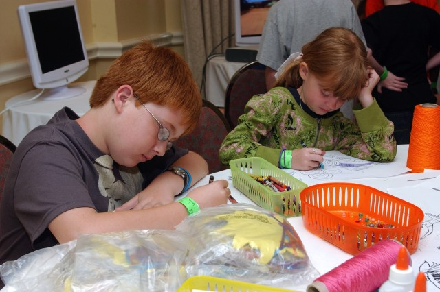 Austin Hill, 11, and his younger sister Jessy, 8, children of Sgt. James and Keri Hill, spend time coloring during the Yellow Ribbon Reintegration Workshop held in Orlando April 17-19. Sponsored by 81st Regional Support Command, the workshop brought nearly 700 Soldiers and their families for the three-day event to assist them with the tools to succeed after a deployment. Soldiers are given timely information about available services and referrals, and provide a proactive outreach to help overcome the stresses of deployment.""