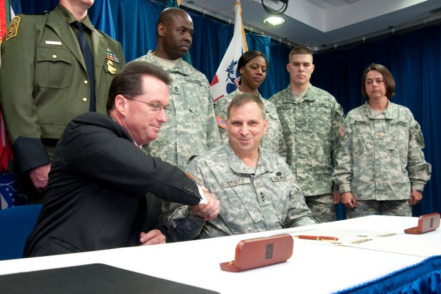 Jason P. Ahern, acting commissioner, U.S. Customs and Border Protection (left) and Lt. Gen. Jack C. Stultz, chief, U.S. Army Reserve (right) sign the official Employer Partnership Initiative agreement in Washington, D.C., April 21.