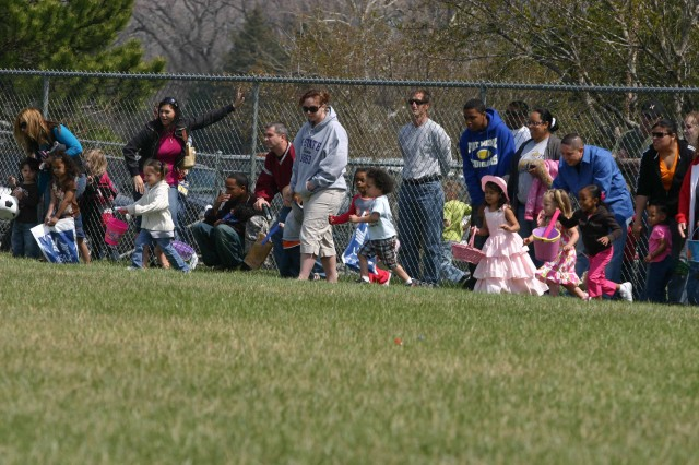 Children in the 3 to 4 age group run out to find eggs April 11 during the Easter Egg Hunt at Sacco Softball Complex.  Before the egg hunt, children were able to participate in different activities including a balancing egg race.