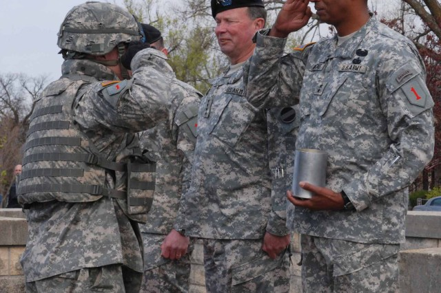 Maj. Gen. Vincent Brooks receives an artillery shell April 15 duirng the 1st Inf. Div. assumption of command ceremony at Cavalry Parade Field.