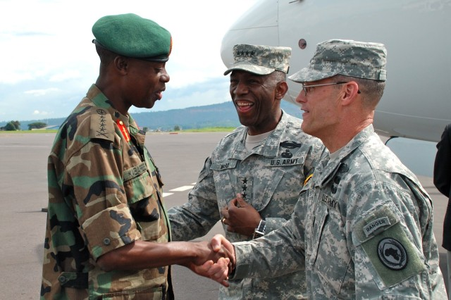 """Gen. James Kabarebe, Rwandan Defense Force Chief of Defense Staff (left), greets Gen. William E. """"Kip"""" Ward, commander of U.S. Africa Command (center), and U.S. Africa Command Sgt. Maj. Mark Ripka (right) in Kigali, April 20, 2009. Ward, leading an U.S. Africa Command delegation on an official visit to Rwanda, met with U.S. Ambassador to Rwanda Stuart Symington IV and other U.S. embassy officials after arrival."""