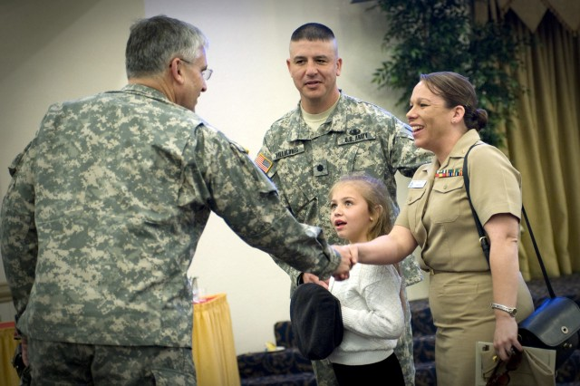 U.S. Army Gen. George W. Casey, Jr., chief of staff of the Army, congratulates Lt. Col. Villalobos and his family at his changing of command luncheon April 2, 2009, at Ft. Hood, Tex. (U.S. Army photo by D. Myles Cullen/Released)