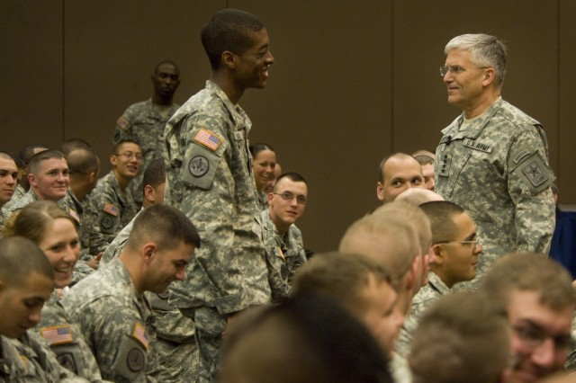 U.S. Army Gen. George W. Casey, Jr., chief of staff of the Army, and a Soldier share a laugh at the beginning of a meeting in Ft. Hood, Tex., after the Chief asks the Soldiers about their most memorable recollections of their time in Iraq April 2, 2009. (U.S. Army photo by D. Myles Cullen/Released)