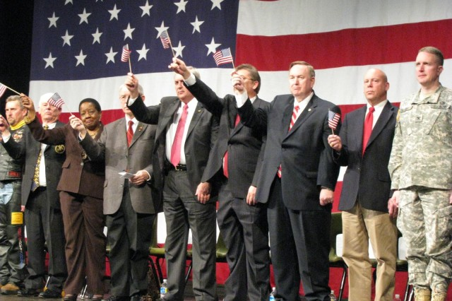 """Dignitaries show their support for Soldiers of the Reserve's 375th Engineer Company during the April 11 deployment ceremony. From left are Robert """"Gator"""" Collins of the Patriot Guard Riders, Mike Howell of the Redstone-Huntsville Chapter of the Association of the U.S. Army, State Reps. Laura Hall, Howard Sanderford, Butch Taylor and Randy Hinshaw, State Sen. Tom Butler, Jim McCamy representing U.S. Rep. Parker Griffith, and Garrison commander Col. Bob Pastorelli."""