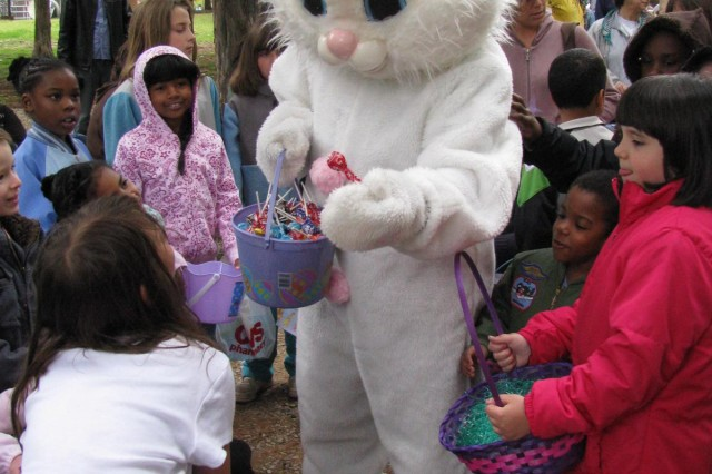 The Easter bunny offers suckers to children waiting to participate in the annual Easter Egg Hunt on April 11 at Vincent Park. The Easter bunny makes an appearance every year at the hunt, hosted by FMWR's Child Youth and School Services. More than 500 children enjoyed the bunny's visit and then the hunt itself.