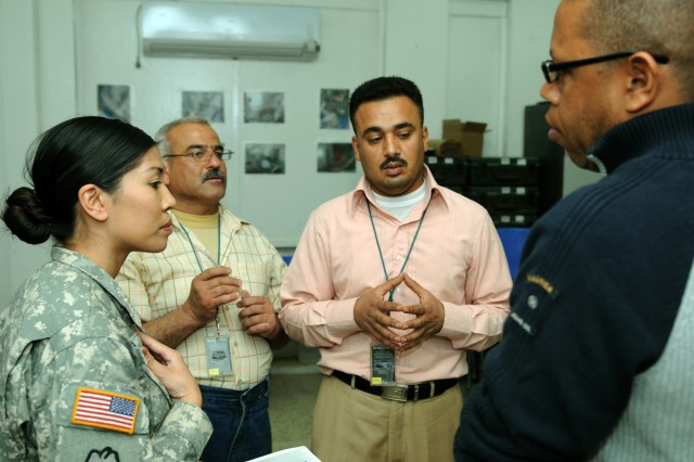 An Iraqi medical professional from the Tikrit General Hospital explains the procedure of evaluating casualties to Staff Sgt. Grace David, noncommissioned officer in charge of medical training and education, Co. C, 325th Brigade Support Battalion, 3rd Infantry Brigade Combat Team, 25th Infantry Division during pre-hospital care training.