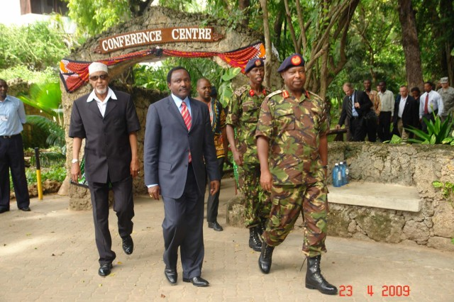090423-KENYAMAKORI005.JPG (Pictured from left)  Yusuf Haji, Minister of State for Defence, Stephene Kalonzo Musyoka, M.P., Vice President of Kenya, and Lt. Gen. Jackson Tuwei, Kenya Army commander leave the closing ceremony of the 2009 Land Forces Symposium in Mombasa, Kenya, April 23. More than 20 delegates attended the symposium which was co-hosted by the Kenya Army and U.S. Army Central. (Photo by Kenya Navy Senior Sgt. James Makori)
