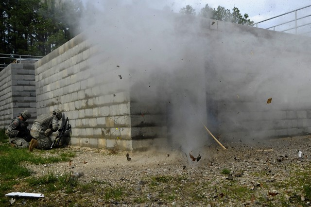 """Two-person engineer teams use explosives to gain entry to a MOUT site during a round robin of events in the second phase of the 2009 """"Best Sapper"""" competition at Fort Leonard Wood, Mo.  A total of 34 teams from as far away as Hawaii and Germany competed in this year's event."""