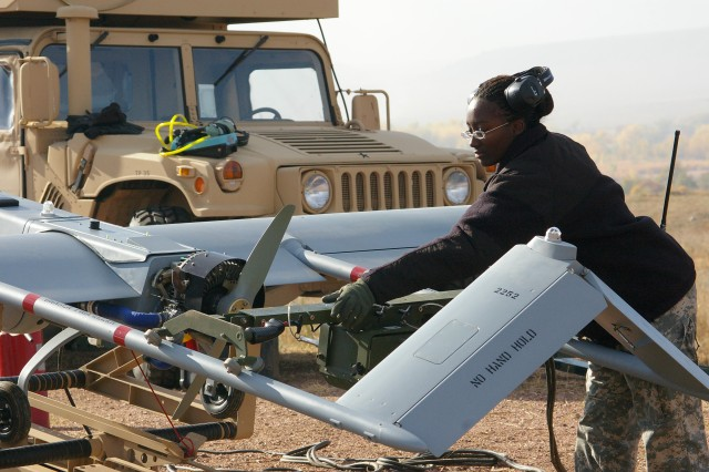Staff Sgt.  Adrienne Kambouris, Company B, 4th Brigade Special Troops Battalion, 4th Infantry Division at Fort Carson, Colo., readied an Unmanned Aerial Vehicle for flight. She is married to Warrant Officer Steven Kambouris, also on assignment at Fort Carson, who she met shortly after entering the Army in 2002.