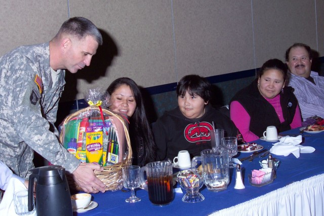 Maj. Gen. Oates, Commander of the 10th Mountain Division (Light Infantry), offers a gift for the Onondaga Nation School at a recent Head of State visit. Educational partnerships have been one of the ongoing strengths of the Fort Drum cultural resources management program. The program won the fiscal 2008 Department of Defense Environmental Award for cultural resources management.