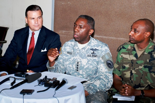 "KIGALI, Rwanda - General William E. ""Kip"" Ward, commander of U.S. Africa Command (center), answers a local reporter's question during a press conference April 22, 2009 in Kigali, Rwanda. U.S. Ambassador to Rwanda Stuart Symington IV (left), and Rwandan Defense Force spokesman Major Jill Rutaremara (right), also fielded questions. Ward led a U.S. Africa Command delegation on this official visit to meet with RDF officials and tour RDF facilities."