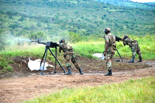 "KIGALI, Rwanda - Rwandan Defense Force (RDF) soldiers fire machine guns scoring direct hits on targets during a live-fire demonstration April 21, 2009, at the RDF's Gabiro School of Infantry in Gabiro, Rwanda. The demonstration was part of a tour for a U.S. Africa Command delegation led by General William E. ""Kip"" Ward, commander of U.S. Africa Command. RDF soldiers also displayed their technical proficiency with small arms and rocket-propelled grenades."