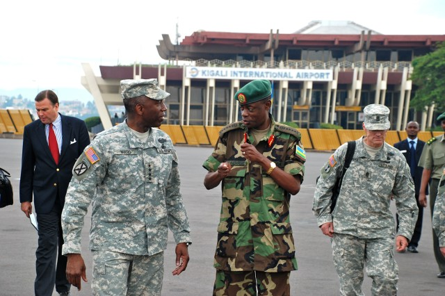 "KIGALI, Rwanda - Rwandan Defense Force (RDF) Chief of Defense Staff General James Kabarebe (right) shares some final thoughts with General William E. ""Kip"" Ward, commander of U.S. Africa Command (left), before Ward left Rwanda April 22, 2009, after a two-day visit. Ward led a U.S. Africa Command delegation on this official visit to meet with RDF officials and tour RDF facilities."
