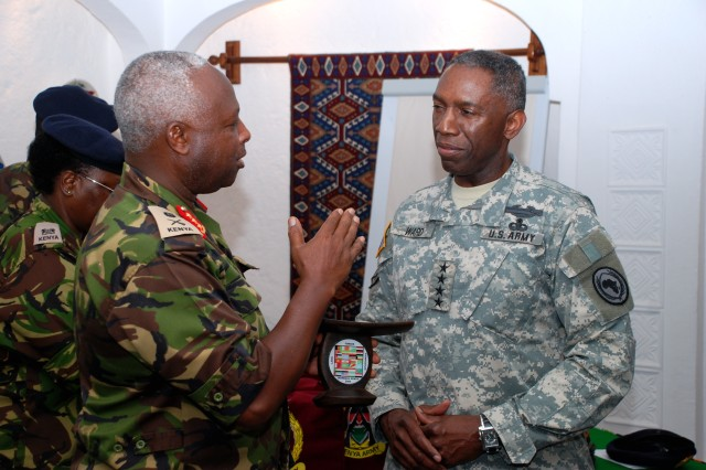 "MOMBASA, Kenya - Kenyan Army Commander Lieutenant General Jackson Tuwei (left) presents a memento to General William E. ""Kip"" Ward, commander of U.S. Africa Command (right), during the Land Forces Symposium, April 22, 2009. The symposium, organized by the Kenyan Army and U.S. Army Central, is an annual forum that brings together international military leaders to discuss common challenges, exchange views, and foster security cooperation throughout the Horn of Africa, the Middle East, and South Asia. Ward attended sessions April 23 after a two-day visit to Rwanda. Beginning next year, U.S. Africa Command's Army component, U.S. Army Africa, will become the lead U.S. Army organization to plan the event."