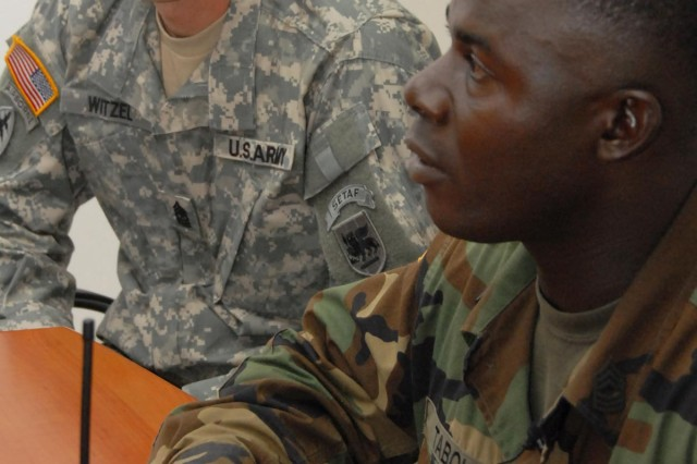 Sgt. Maj. Bryan Witzel, U.S. Army Africa, listens to Armed Forces of Liberia Sgt. Major William Tabolo during an NCO sensing session held at Camp Sandi Ware in Careysburg, Liberia.