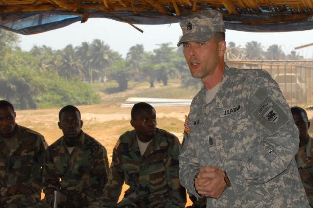 During a recent U.S. Army Africa visit to Liberia, Sgt. Maj. Bryan Witzel motivates Armed Forces of Liberia troops who serve in the field of supply and logistics.