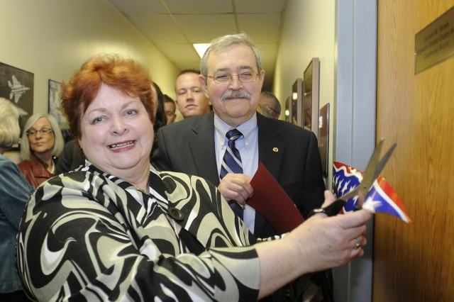 Jan Vanek (with scissors), and Frank Vanek, the parents of Sgt. Joe Vanek, cut the ribbon to officially open the Joseph M. Vanek Ceremony Room at the Chicago Military Entrance Processing Station. The room - where new recruits swear their oath of allegiance upon entering the military - was re-named in Sgt. Vanek's honor during a ceremony April 20, attended by family, friends, and members of Vanek's old unit, Company C, 2nd Battalion, 325th Airborne Infantry Regiment, 82nd Airborne Division. Sgt. Vanek, an infantry squad leader, was killed in Iraq in 2007.