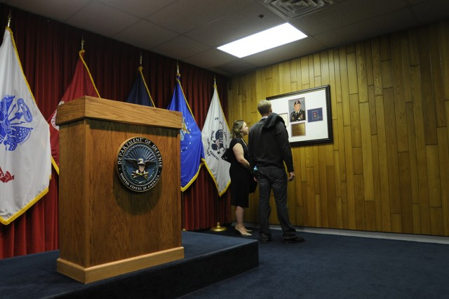 Ann Vanek (left), sister of Sgt. Joe Vanek, and a family friend spend a quiet moment reflecting beneath a plaque in Sgt. Vanek's honor hanging in the Joseph M. Vanek Ceremony Room at the Chicago Military Entrance Processing Station. The room - where new recruits swear their oath of allegiance upon entering the military - was re-named in Sgt. Vanek's honor during a ceremony April 20, attended by family, friends, and members of Vanek's old unit, Company C, 2nd Battalion, 325th Airborne Infantry Regiment, 82nd Airborne Division. Sgt. Vanek, an infantry squad leader, was killed in Iraq in 2007.