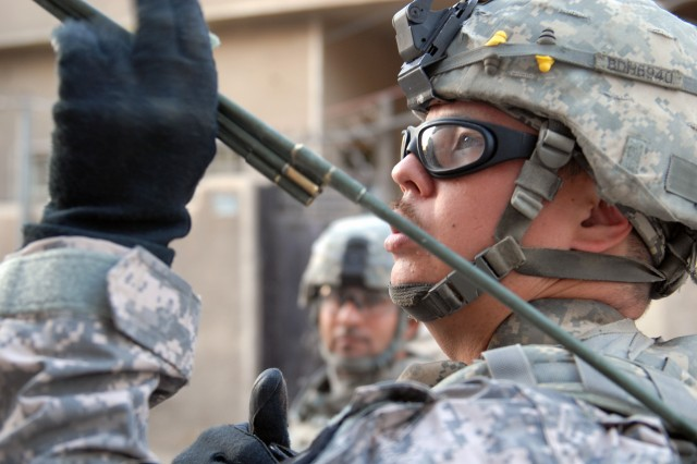 Dallas native, Spc. Jimmy Howard of C Company, 2nd Battalion, 5th Cavalry Regiment, adjusts the antenna of his radio in Sadr City, April 20.