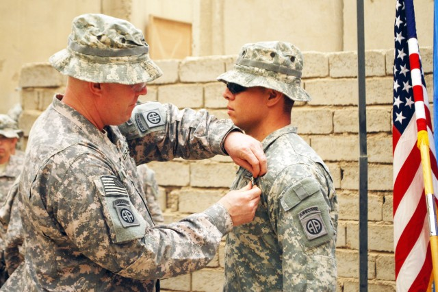 BAGHDAD - Col. Timothy McGuire (left), commander of the 3rd Brigade Combat Team, 82nd Airborne Division, Multi-National Division-Baghdad pins an Army Commendation Medal with Valor on Spc. Gaspar Grijalva, during a ceremony April 25 at Joint Security Station Loyalty. The El Paso, Texas native treated wounded Paratroopers while being attacked by enemy combatants on the evening of Jan. 10. Grijalva is assigned to Company D, 2nd Battalion, 505th Parachute Infantry Regiment, 3rd BCT, 82nd Abn. Div. based out of Fort Bragg, N.C.