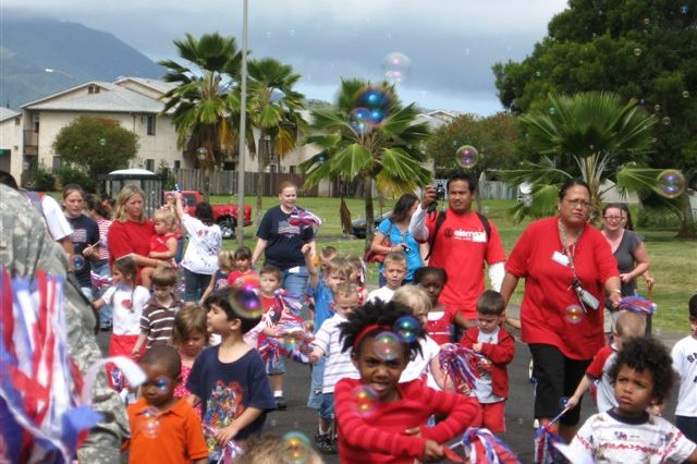 HELEMANO MILITARY RESERVATION, Hawaii -The Child Development Center', here, held a parade, April 16, in honor of Month of the Military Child (MOMC). Escorted by the U.S. Army Garrison-Hawaii military police and fire department, more than 175 children and parents marched to patriotic songs, blew bubbles and had fun celebrating the military's smallest heroes.