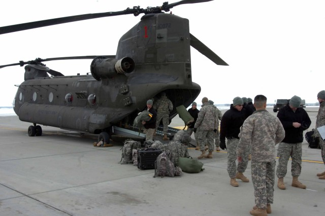 On the ground in North Dakota, the CAB, 1st Inf. Div. crews off load the helicopters. The Soldiers flew to North Dakota to help with flood relief.
