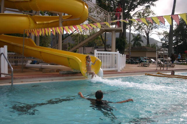 SCHOFIELD BARRACKS, Hawaii - A young girl makes a splash at the bottom of the new 146-foot slide at Richardson Pool, Schofield Barracks.