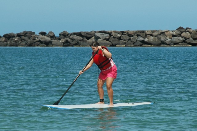 WAIANAE, Hawaii - Suzanne Tuten shows off her paddling expertise after one short lesson from Outdoor Recreation during the Blue Star Card event at Pokai Bay, April 16.